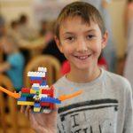 SOS Village - A Proud Kid with his Dream School Built of Lego Bricks