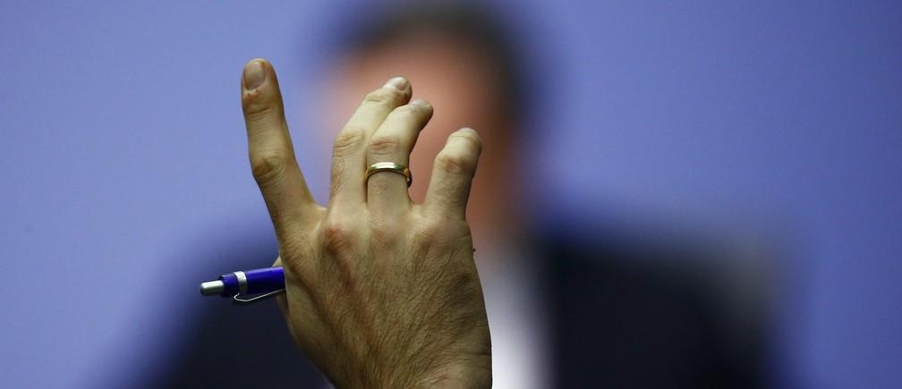 Image of Hand via Reuters by Kai Pfaffenbach